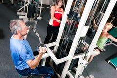Three senior people in gym royalty free stock photo