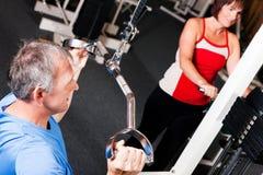Three senior people in gym Royalty Free Stock Image