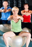Three senior people in gym Stock Photography