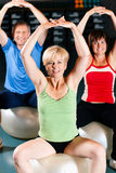 Three senior people in gym Royalty Free Stock Photos