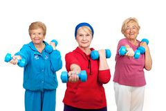 Three senior women doing workout. Three healthy senior women doing workout with weights.Isolated on white Royalty Free Stock Photography