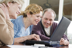 Three Seniors on a laptop Stock Photo