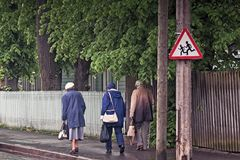 Three Seniors Walking Back From The Shops royalty free stock photography