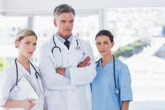 Three serious doctors Stock Photos