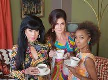 Three Serious Tea Drinkers Stock Photo