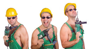 Three serviceman. With hand drill stock photography