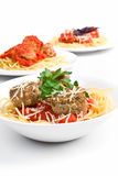 Three servings of spaghetti with meatballs Stock Photos