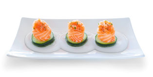 Three servings of sushi salmon and cucumber filling. Stock Image