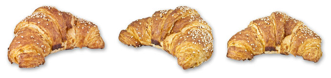 Three sesame croissants. Three isolated sesame crossaints with shadow on a white background stock illustration