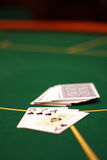 Three seven ace. Pack of cards on a table and three opened cards Stock Photography