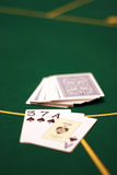 Three seven ace. Pack of cards on a table and three opened cards Stock Image