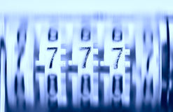 Three sevens on the old rotating counter. Jackpot! Stock Photos