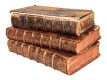 Three seventeenth century antique books. Stack of three seventeenth century antique books isolated on white Stock Photo