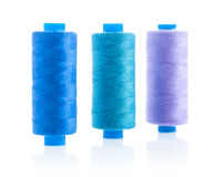 Three sewing bobbins Stock Images