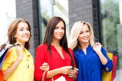 Three beautiful women with packages being happy Stock Photography