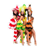 Three sexy carnival dancers posing. Against isolated white background Royalty Free Stock Photos