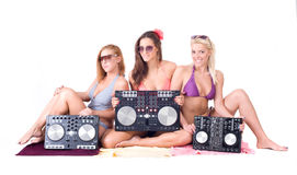 Three sexy girl posing with audio equipment Royalty Free Stock Image