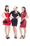 Three girls posing in fashion dresses Stock Photo