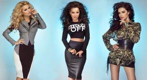Three sexy girls posing in studio Royalty Free Stock Photos
