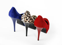 Three heels. Three shoes on a white background royalty free stock image