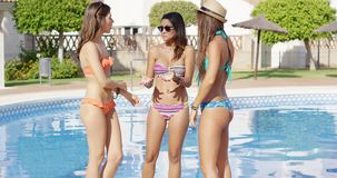 Three sexy trendy women in bikinis stock video