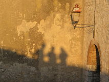 Three shadows on a wall at sunset Royalty Free Stock Images