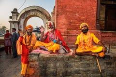 Three Shaiva sadhus in ancient Pashupatinath Temple, Nepal Royalty Free Stock Photo