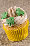Three shamrocks on a cupcake Stock Photos