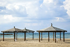 Beach. Three sheds on the beach in a lovely winter day with dramatic sky Royalty Free Stock Images