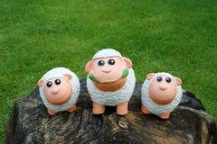 Three sheep on the stone. Three smiling sheep on the stone royalty free stock photos