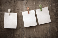 Three sheets of paper on clothespins Royalty Free Stock Photo