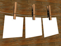 Three sheets of the paper, hanging on a cord. Stock Images