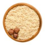 Three Shelled Hazelnuts On Hazelnut Meal In Wooden Bowl Royalty Free Stock Image