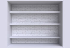 Three shelves on the wall. Royalty Free Stock Photography