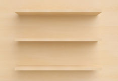 Three shelves on the wall. Royalty Free Stock Image