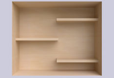 Three shelves on the wall. Stock Photography