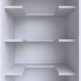 Three shelves on the wall. Stock Image