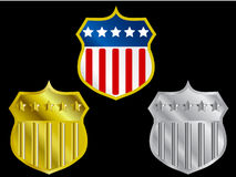 Three shields with US flag. Medals with USA flag in gold and silver stock illustration