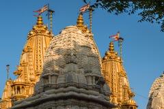 Three shikhara BAPS Shri Swaminarayan Mandir.Shahibaug stock photo