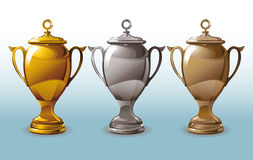 Three shining Cup. The set of three shiny cups for first, second and third places Stock Photography