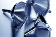 Three shiny funnels Stock Photo