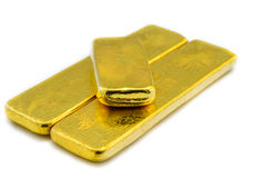 Three shiny gold bars on white. Photo taken on: 14/072013 Royalty Free Stock Photography