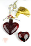 Three Shiny Hearts. One red glass heart, one red crystal heart, and one pink quartz heart on white background Royalty Free Stock Photos