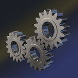 Three shiny metal gears. Meshing together on dark blue black background Royalty Free Stock Photos