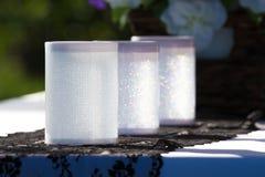 Three shiny wedding candle holders Stock Images