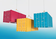 Three shipping containers on the hooks - render cutting path. Three metal freight shipping containers red, yellow and blue on the hooks at sky background Royalty Free Stock Photos