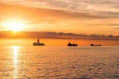 Three ships at anchorage Stock Images