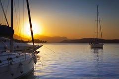 Three ships in Poros harbor, Greece. Three ships at sunset in Poros harbor, Greece Stock Photography
