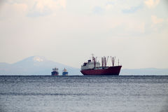 Three ships and snow capped mountains Royalty Free Stock Photo