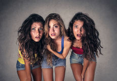 Three shocked girls Stock Image